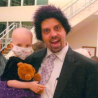 Father holding cancer-stricken child